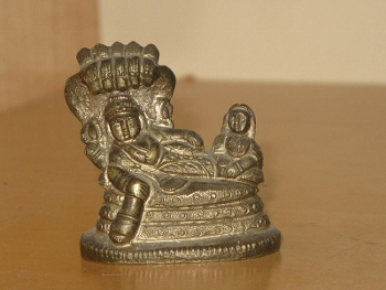 Vishnu and Lakshmi on giant snake