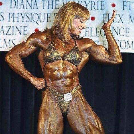 Woman bodybuilder with supertanned supermuscles