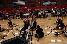 People with cerebral palsy can compete in sitting volleyball