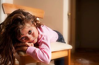 If a child is overwhelmed by school, she may tune out the teacher and show symptoms of boredom.