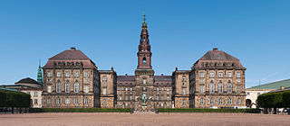 Look at the image of the Christiansborg Palace in Copenhagen. This is a  highly symmetrical building, so it shouldn't take you too ...
