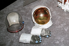 Gold face shield on astronaut helmet
