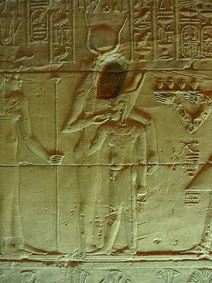 A carving of Isis feeding a pharaoh from the Temple of Isis at Philae Island
