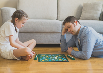 A family plays scrabble during winter break