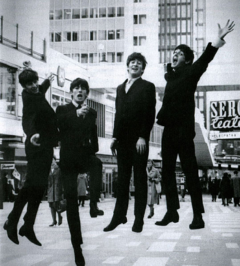 An image of the Beatles leaping into the air