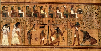 Egyptian scene of the heart of the dead being weighed against the feather of Maat by Anubis while Ammut waits