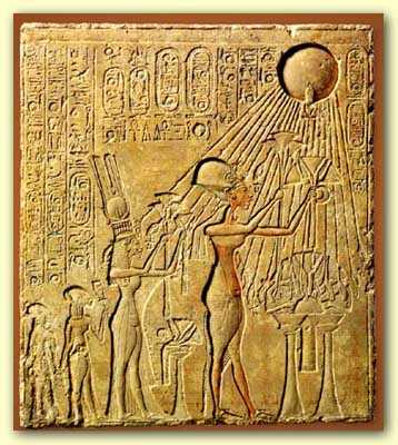 Akhenaten, with womanly hips and breasts, worshiping the Aten disk