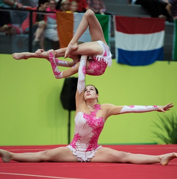 Two athletes using balance in gymnastics