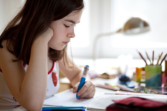 Young girl completing homework