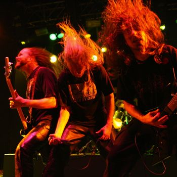Heavy metal/death metal band, Asphyx, head banging during a performance.