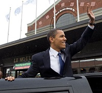 Obama waves to the crowd.