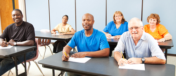 A diverse group of adult learners taking advantage of tuition reimbursement