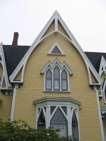 Steep Gable Roof And Arched Windows