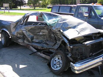 A car that has been badly damaged in an accident.