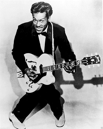 An image of Chuck Berry with his guitar