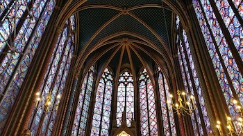 Interior Of A Gothic Church With Stained Glass Windows