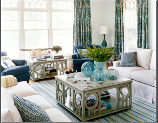 A Coastal Room Filled With White Furniture And Blue Green Accents