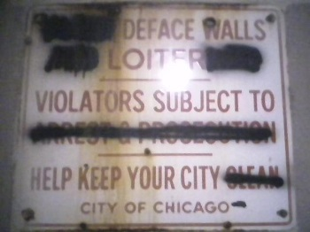 Defaced No Loitering Sign