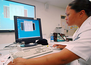 A healthcare provider is shown using an EMR.