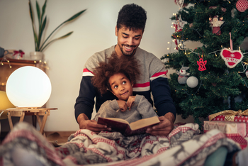 A family reads holiday classics together during winter break