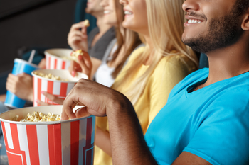 People at a movie theater eat popcorn