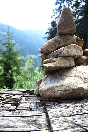 Stones stacked in a roughly pyramid shape