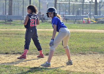 girls on fast-pitch little league