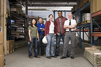 A warehouse manager with employees