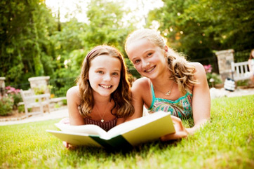 Girls reading books together