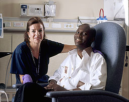 Cancer patient with his nurse