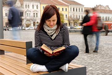 A student reads in the city