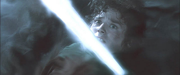 Movie still depicting Frodo with the Nazgul