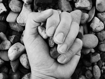 Image of stones in hand.