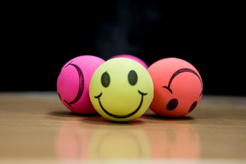 Smiley-face stress balls in a variety of colors.