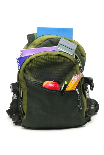 backpack containing test day items not to forget, apple, and pencils