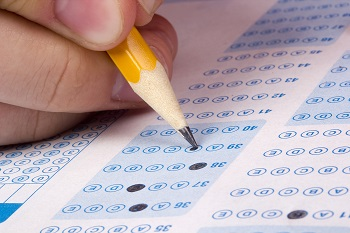 pencil filling in exam bubbles on a test form