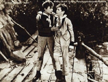 Huck Finn and Tom Sawyer in a 1920 movie adaptation