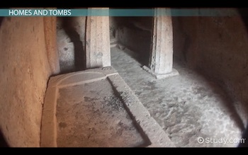 inside of Etruscan tomb showing a bed