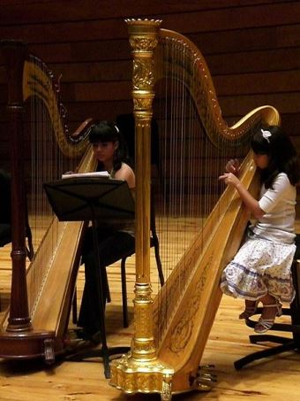 two girls playing harp