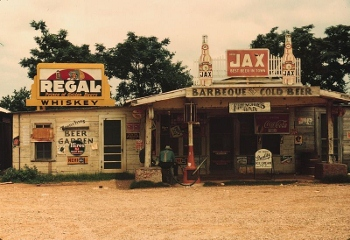 A store, bar, and gas station in 1940s Louisiana