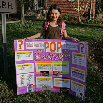 A girl showing off her completed project.
