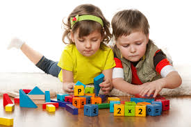 young children learning with blocks